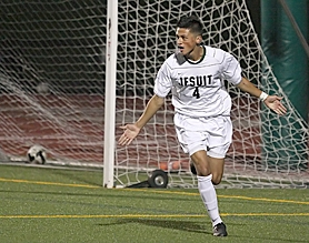 by: Miles Vance EARLY LEAD — Jesuit senior Keenan dePinna celebrates after scoring the first goal in his team's 2-2 tie with Westview in Metro League play on Monday night at Jesuit High School.
