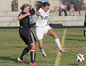 by: Miles Vance GOING STRONG — Valley Catholic's Chelsea Alsdorf dribbles past Horizon Christian's Jessica Murrell during her team's 9-1 victory over the Hawks at Valley Catholic High School on Sept. 21.