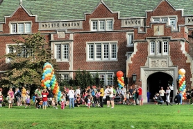 by: David F. Ashton Balloons welcome families as they play on the lawn in front of the Old Dorm Block building on Reed College's hundredth anniversary, September 25th.