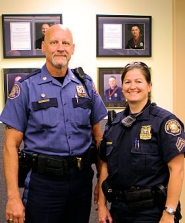 by: David F. Ashton Portland Police Bureau East Precinct Commander Michael Lee stands with Sgt. Wendi Steinbronn.