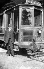 by: Courtesy of Judith Leppert William E. Leppert, shown while he was conductor, based in Sellwood, for the Portland Electric Trolley Line. The picture was taken sometime in the 1920's.