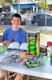 by: Rita A. Leonard Clancy O'Connor, 14, volunteered at the BAC raffle booth, passing out prizes & gift certificates from local businesses.