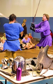 by: David F. Ashton Sword fight in Sellwood Community Center!