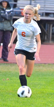 by: John Brewington DOUBLE DUTY—Scappoose's Charlie Davidson has been a big part of the soccer team and also one of the top runners on the cross country team.