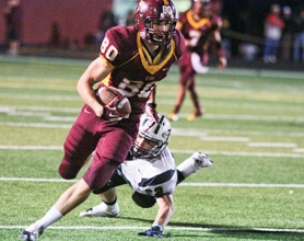 by: Chase Allgood Forest Grove wideout Chris Wertz (80) slips past Tigard's Isaac Schimmels during last Friday's Pacific Conference football game.