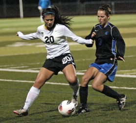 by: DAN BROOD KEEPING CONTROL — Tualatin freshman defender Natalie Chen (left) keeps the ball away from Kylee Taube in Tuesday's match. The Wolves won 10-0.