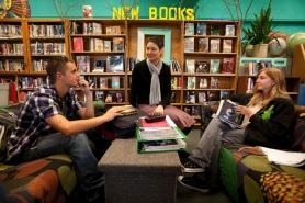 by: CHRISTOPHER ONSTOTT Madison High School librarian Nancy Sullivan (center), talks with high school seniors Josh Wright (left) and Taylor Beach about what they're reading these days. Fewer than half of the Portland Public Schools have a licensed librarian, full-time or otherwise.
