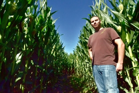by: VERN UYETAKE It isn't hard to get lost in the Fiala Farms corn maze in the Stafford area.  Cole Fiala shows one of the routes through the 8- to 10-foot-high cornstalks.  The maze features 4-foot-wide trails and is open to the public.