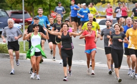 by: Vern Uyetake Paula Harkin, of West Linn, raises her arms in celebration of her 1,000th run in 1,000 days.