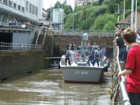 by: Submitted photo The PT 658 backs out of the Willamette Falls Locks during Lock Fest 2005. The patrol torpedo boat now looks different, with a new paint job, but several members of the crew from that day will be featured in a new book by Sandy Carter.