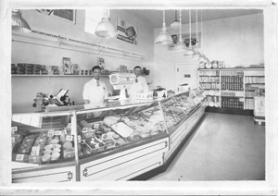 by: contributed photo by ED HOFFMAN In this interior view of the Sandy Market in the late 1940s, Bob Jensen, left, and store owner Ruben Hoffman are seen behind the meat counter, which was located where the library's circulation desk was positioned.