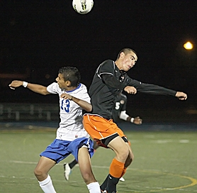 by: Miles Vance AIR WAR – Aloha junior Gerson Cordon (left) and Beaverton senior Austin Coward get airborne to battle for a header during Beaverton's 4-0 win on Monday night at Aloha High School.