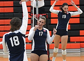 by: Miles Vance WINNERS — Westview's Jackie Stein (center) celebrates a point with teammates Carly Steindorf (left) and Jessica Lautenback during their team's three-game sweep of Beaverton last week.