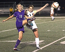by: Miles Vance JOUST — Sunset's Emmy Owens (left) and Southridge's Ariel Kanable battle for the ball during the Apollos' 2-0 win at Southridge High School on Sept. 29.