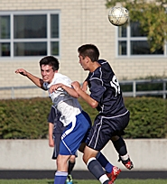 by: Miles Vance GOING STRONG — Valley Catholic senior defender Alex Vennes (left) goes up for a header during his team's 2-0 loss to Faith Bible last week.