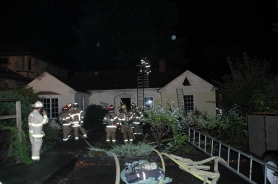 by: submitted Firefighters battle a fire on Lake Front Road. No one was injured in the Wednesday night blaze, which caused more than $70,000 in damages to the house and its contents.