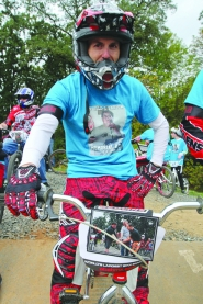 by: Courtesy photo MEMORIES — BMX riders wore Phil Barlow T-shirt's to honor the memory of the late city councilor and biking supporter who died late last month.