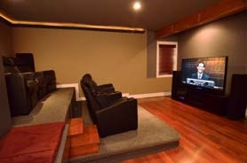 by: VERN UYETAKE The basement of this Lake Oswego home was transformed from an unused basement to a tiered movie theater – complete with a wine cellar and wet bar in about two months. Designer Sheila Carlson with MRC Builders said that transitions like this are perfect for fall weather – and just in time for the holidays.