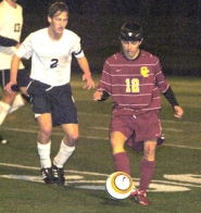 by: David Ball Central Catholic's Peter Bergmann plays a ball in the midfield, while Barlow's Boo Smith provides some defensive pressure.