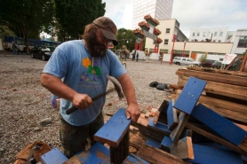 by: Christopher Onstott Brad Gipson starts construction on a fence made of doors that the will surround an empty lot, turned homeless camp at the corner of Northwest Fourth Avenue and West Burnside Street. 