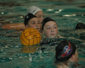 by: Kris Anderson Cherie Schaffer is among a group of freshmen playing water polo for the first time.