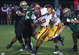 by: MILES VANCE Central Catholic senior Moli Langi runs for yardage in an early-season game against Jesuit.