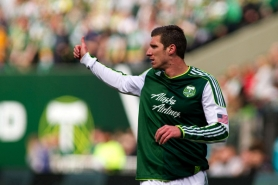 by: CHRISTOPHER ONSTOTT Portland Timbers striker Kenny Cooper gives thumbs up to a teammate in an early-season home victory over FC Dallas. The Timbers, under coach John Spencer, have preached unselfish play throughout the season, which is nearing its final week before the playoffs.