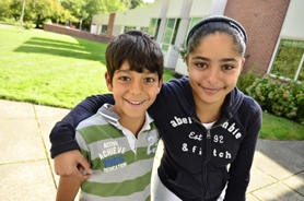 by: VERN UYETAKE Fourth-grader Antonio Miguel-Vivanco, left, and his sixth-grade sister, Isabella, are from Mexico.