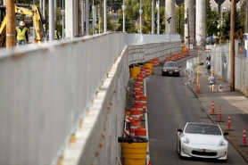 by: CHRISTOPHER ONSTOTT Cars can drive on the original Southwest Moody Avenue until the new elevated version on the right opens next month. It will eventually include car lanes and tracks for both Portland Streetcars and MAX trains.