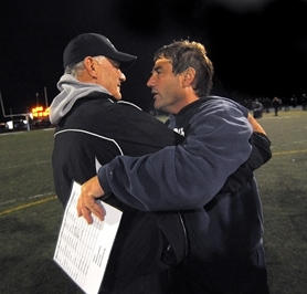 "by: VERN UYETAKE Immediately after the ""Battle of the Lake"" Friday evening at Lakeridge High School, Pacer coach Tom Smythe and Lake Oswego High School coach Steve Coury hugged each other at midfield. The Lakers won the game 55-34. The first thing Smythe said to his long-time friend Coury was, ""You guys are good."" For more on the game, see page A18."