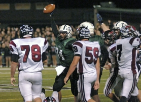 by: DAN BROOD I GOT IT — Tigard senior Nolan Friesen holds up the football after recovering a fumble in Friday's Pacific Conference showdown. The Tigers got a 35-7 victory.