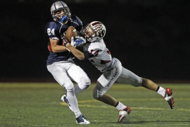 by: Jaime Valdez GOTCHA — Sherwood senior defensive back Chase Krieger (right) tackles Wilsonville's Jayden Cooper. Krieger had 11 tackles and an interception in the win.