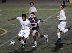 by: DAN BROOD IN ACTION – Sherwood's Nathan Anderson (7) battles Wilsonville's Achmat Jappie for the ball.
