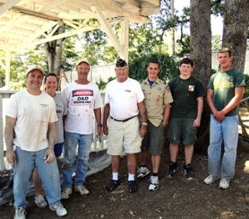 by: Submitted photo Tigard Scout Alec Trecker is flanked by American Legion Post 158 members after his Eagle project, on behalf of the post.