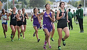 by: Miles Vance IN THE LEAD – Jesuit's Adrienne Demaree (right) and Sunset's Karen Qu lead the pack in the Metro League-opening race at Sunset High School on Oct. 5. Demaree went on to win the 5-kilometer race while Qu placed second.