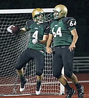 by: Miles Vance FLYING HIGH — Jesuit tailback AJ Glass (left) and lineman Maka Moon celebrate one of Glass' two touchdown runs.