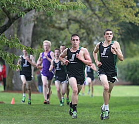 by: Miles Vance OUT IN FRONT – Jesuit's David Leavy (center) and Hunter McGuirk ran to a 1-2 finish in the Metro League meet at Sunset High School on Oct. 5.