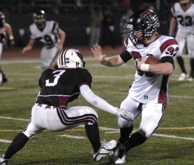 by: DAN BROOD ELUSIVE — Tualatin senior receiver Sumner Patton (right) looks to get away from Glencoe's Austin Tieu in Thursday's game. The Wolves won 44-7.