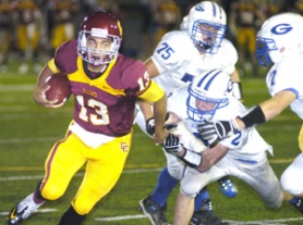 by: David Ball Central Catholic quarterback Aiden Wilder eludes a crowd of Gophers during the first quarter of the Rams 37-13 win Thursday night at Hillsboro Stadium.