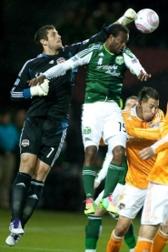 by: CHRISTOPHER ONSTOTT Houston Dynamo goalkeeper Tally Hall knocks the ball away from the Portland Timbers' Jorge Perlaza. Houston scored once in each half to beat the Timbers 2-0 in a key MLS late-season match Friday night at Jeld-Wen Field.