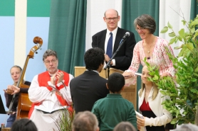 by: Submitted photo New Head of School Mo Copeland receive gifts from students as her husband, Chris, at the lectern, and Oregon Bishop Michael Hanley looks on at her installation ceremony Oct. 7 at Oregon Episcopal School.