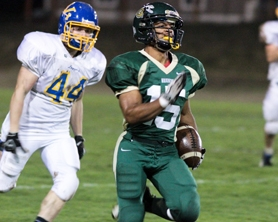 by: Chase Allgood Gaston running back Kevin Reynolds (15) explodes for a 70-yard touchdown during Friday's game against Vernonia.