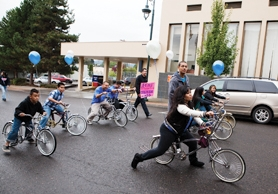 by: Chase Allgood Forest Grove High School Options Club members ride up Main Street on their custom bicycles during the 2011 Homecoming parade Thursday. More photos from celebrations in Forest Grove and Gaston are on page 4B.