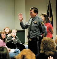 by: Chase Allgood Washington County Sheriff Rob Gordon, seen here talking to residents about Connell House in Cornelius in 2008, will retire at the end of November.
