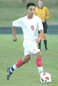 by: Kris Anderson Centennial's Josue Robledo makes a run through the midfield Tuesday.