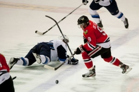 by: CHRISTOPHER ONSTOTT Chase De Leo, Portland Winterhawks center, rushes up the ice in Tuesday's 7-6 shootout victory over Saskatoon.