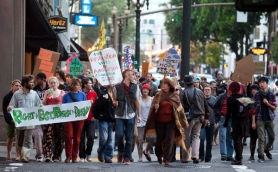 by: CHRISTOPHER ONSTOTT Occupy Portland demonstrators marched up Southwest Fourth Street Tuesday to show solidarity with fellow campers at a site next to the Chinatown Gate. Nevertheless, city officials say the same rules do not apply to the two encampments, one on public property and one on private property.