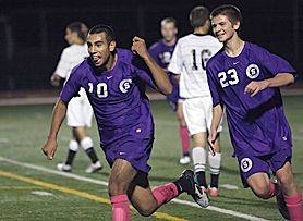 by: Miles Vance PACO TIME — Sunset senior Paco Thomas (left) and teammate Andrew Dorn race upfield after Thomas scored the lone goal in his team's 1-0 win over Jesuit.