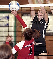 by: David Ball ON THE BLOCK — Valley Catholic's Rebecca Baglai puts up a block against Corbett setter Emma Busk in VC's three-game loss at Corbett on Tuesday.