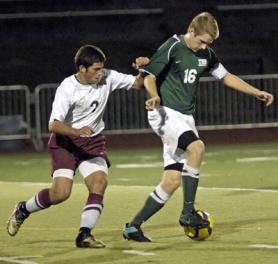 by: DAN BROOD RIVAL RUMBLE — Tigard senior Drew Nyberg (right) tries to stay in front of Tualatin's Domenico Del Prete in Tuesday's match. Nyberg had a goal for the Tigers in their 3-1 win.